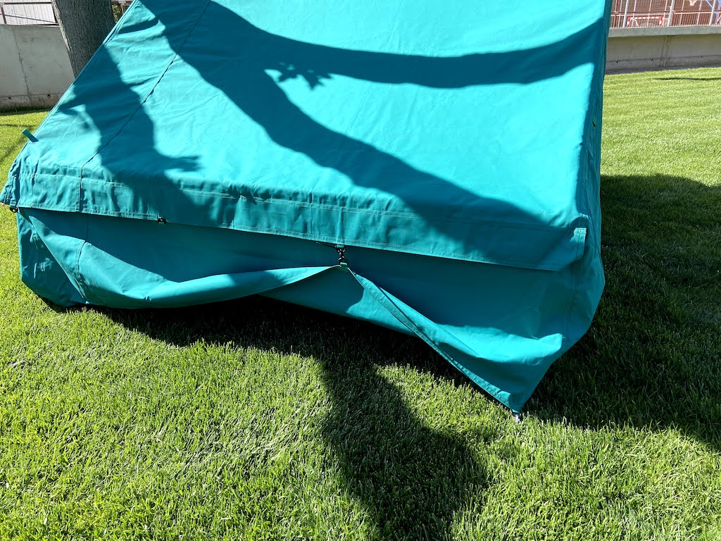 Tent with rolled up side flap